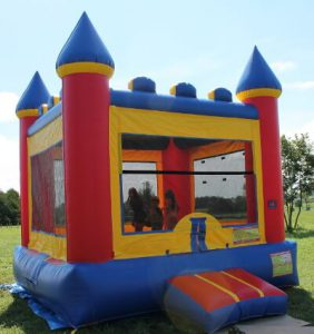 Kids jumping in inflatable jump house.
