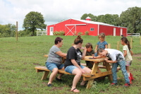 People sitting around a picnic table.